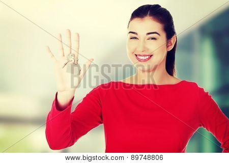 Beautiful caucasian woman holding keys