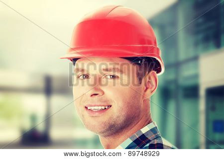 Portrait of handsome engineer in helmet