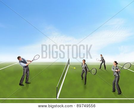 Businesspeople playing tennis