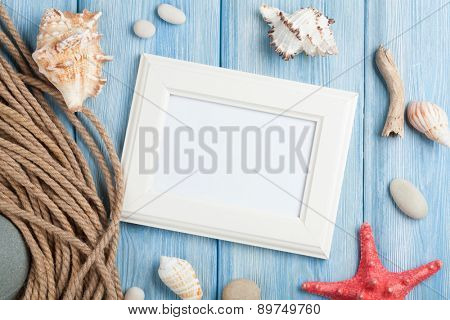 Summer time sea vacation with blank photo frame, star fish and marine rope