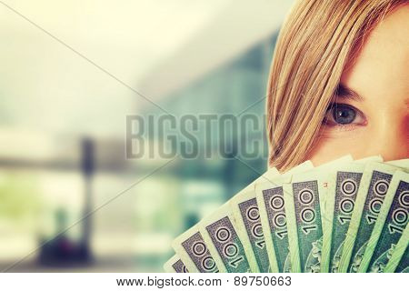 Woman with a clip of polish money