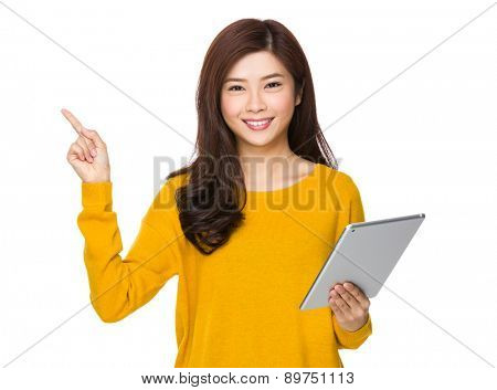 Asian woman hold with digital tablet and finger pointing upwards