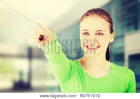 Beautiful caucasian woman pointing somewhere