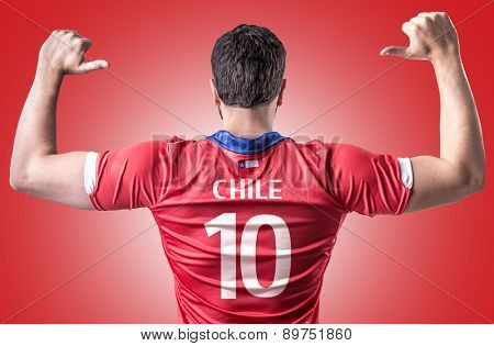 Chilean Soccer player on red background