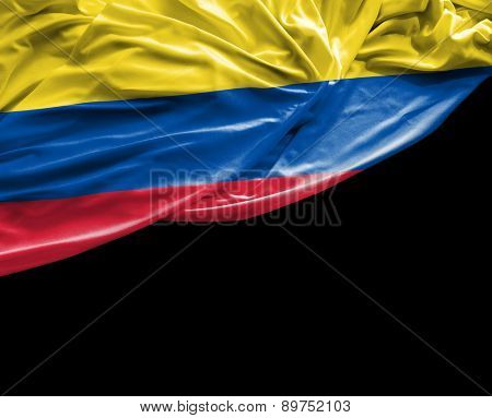 Colombian waving flag on black background