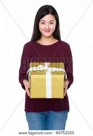 Young woman show with big gift box