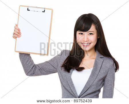 Young businesswoman show with clipboard
