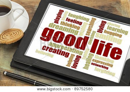 good life - cloud of positive words  on a digital tablet with a cup of coffee