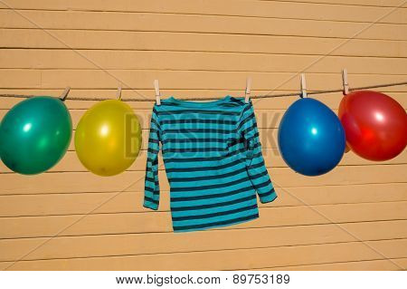 Colorfull Balloons Pinned On A Washing Line