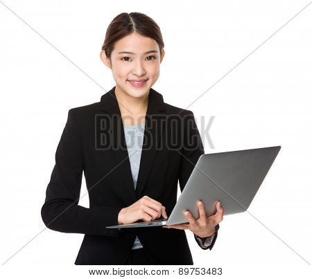 Asian businesswoman use of laptop pc