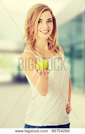 Woman holding a fresh green apple