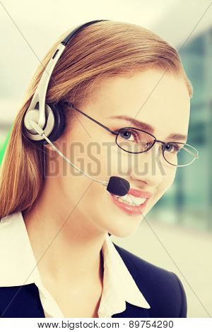 Beautiful caucasian business woman at call center