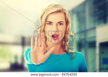 Woman expressing stop sign with her hand