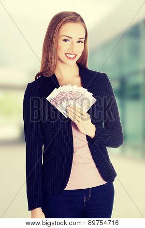 Happy woman holding money clip
