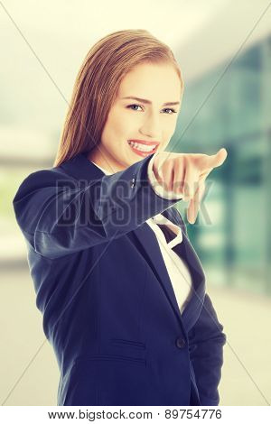 Beautiful business woman is pointing