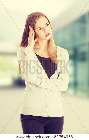 Beautiful casual woman looks worried