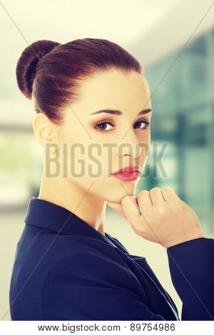 Business woman with hand on a chin.
