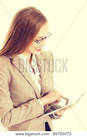 Happy businesswoman surfing on a tablet