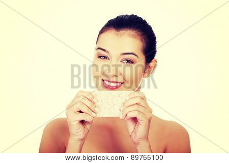 Happy young woman holding crisp bread