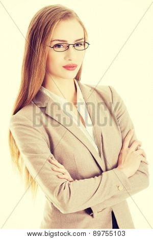 Confident young beautiful businesswoman with hands crossed