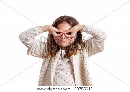 Girl Making Eye Glasses With Hands