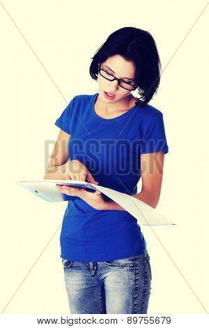 Young beautiful woman holding notes