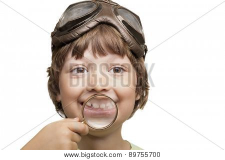 happy boy with magnifying tooth