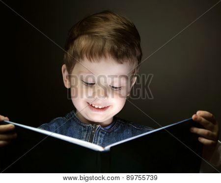 little boy read book