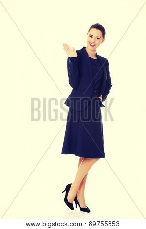 Beautiful businesswoman waving her hand