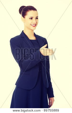 Young and beautiful businesswoman welcoming