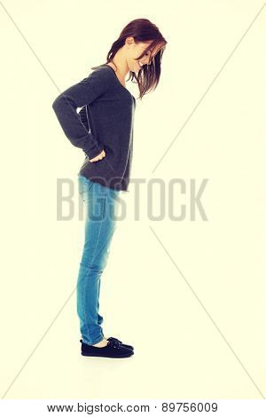 Young woman looking down on the floor