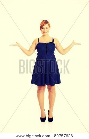 Overweight woman with arms outstretched