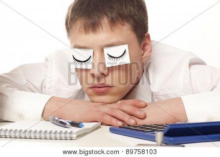 A tired businessman sleeping