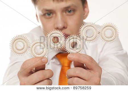 Businessman and teamwork concept with gear in hand