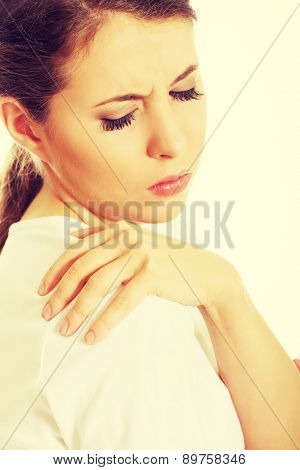 Young woman with shoulder pain