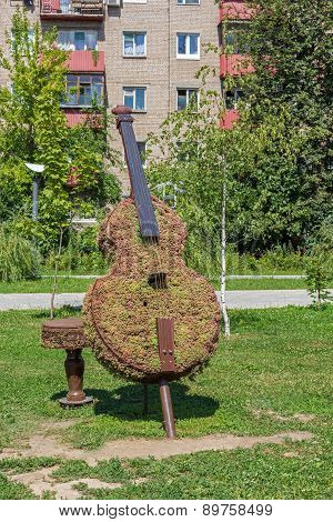 Green Topiary Statue Of Bass Viol