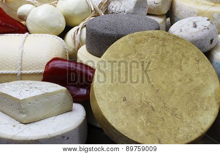 various cheeses on display with pepper
