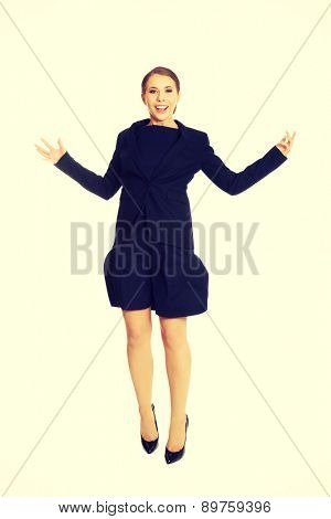 Young beautiful cheerful businesswoman jumping