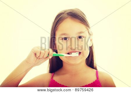 Cute little girl brushing teeth