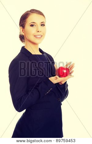 Young beautiful businesswoman holding heart