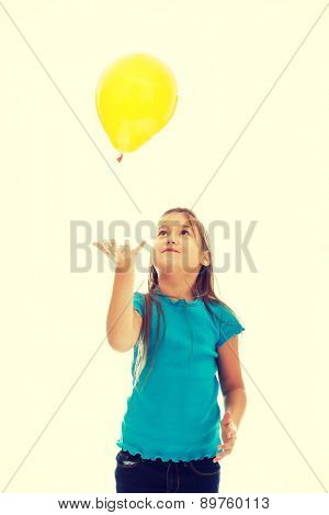 Happy beautiful girl with baloons looking up