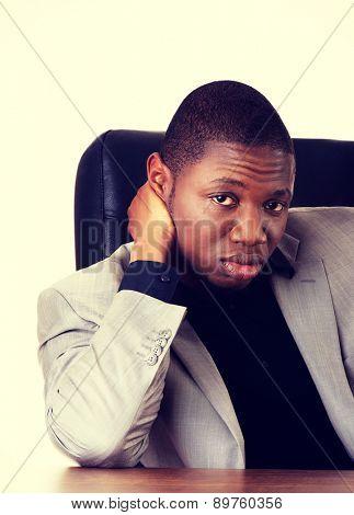 Black handsome man sitting at work
