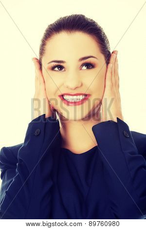 Young businesswoman holding her head