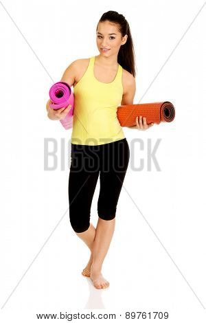 Wxercise fitness woman ready for workout with yoga mats.