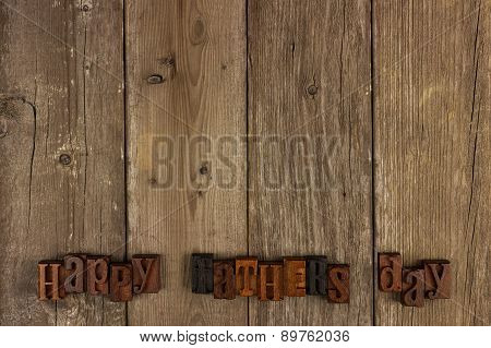 Happy Fathers Day letters on rustic wood