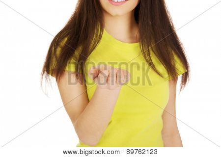 Young student woman showing empty palm.