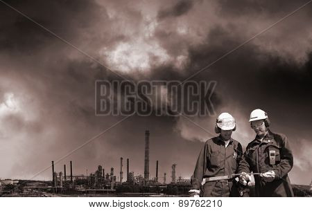 oil gas, fuel and industrial pollution, two workers in foreground, toning concept