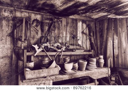 old barn 17th century with tools, pots and pans, vintage effect, analog effects