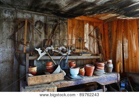 old barn 17th century with tools, pots and pans, vintage effect in natural colors