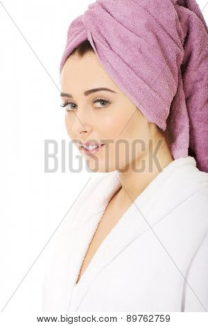 Beautiful spa woman in bathrobe and turban.